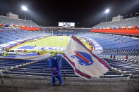 Buffalo Bills fans leave Bills Stadium as a mascot waves a flag after an NFL divisional round football game against the Baltimore Ravens Saturday, Jan. 16, 2021, in Orchard Park, N.Y. The Bills won 17-3. (AP Photo/Adrian Kraus)
