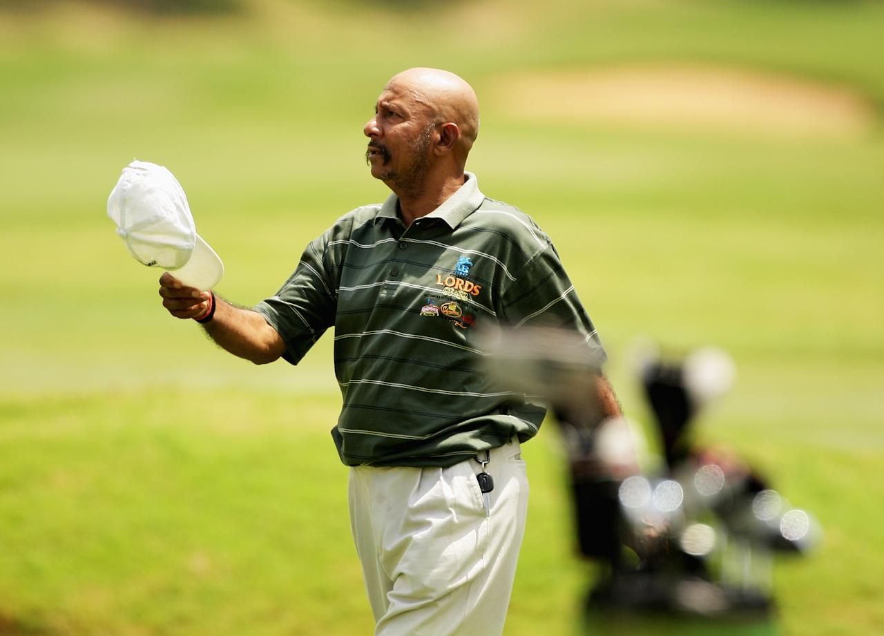 BANGALORE, INDIA - OCTOBER 07:  Syed Kirmani walks off the 18th green during the Airtel Champions League Twenty20 Celebrity Golf Day held at the Karnataka Golf Association Club on October 7, 2009 in Bangalore, India.  (Photo by Mark Dadswell - GCV/Global Cricket Ventures)