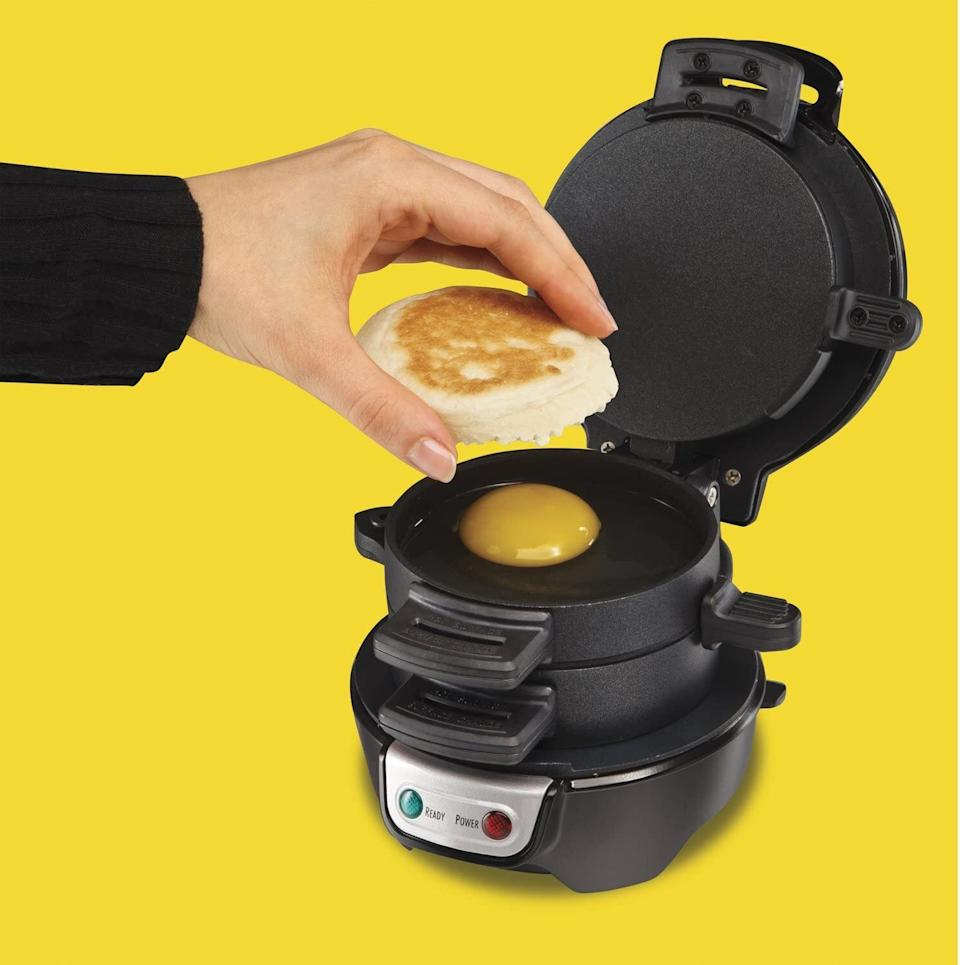 """This is perfect for those rainy Sunday mornings where all you want is a cure to your hangover but can't physically venture farther than the kitchen.<br /><br /><strong>Promising review:</strong>""""I purchased this glorious breakfast sandwich maker and I have to tell you, it's changed my life.<strong>It's slightly contraband being located inside my cubicle and plugged in next to my monitors — but what it's cost me in work appropriateness it's more than made up for in deliciousness, fame, and glory.</strong>I've become a hero among the other analysts: one of them even erected a cardboard idol of my head in tribute. The sandwiches emerge perfectly cooked and heartily delicious. I keep a small spray bottle with a vinegar solution on hand for easy cleaning and to ward off unwelcome visitors and lurking spectators of my epic breakfast delights. And so, I salute you, breakfast sandwich maker — for making me a better and fuller person.<strong>I'm now 100% less hangry and enjoying greater and greater work satisfaction as well as positive interactions with my peers.</strong>Who knew you'd make a good person out of me."""" —<a href=""""https://www.amazon.com/dp/B00C95O3DY?tag=huffpost-bfsyndication-20&ascsubtag=5890048%2C29%2C36%2Cd%2C0%2C0%2C0%2C962%3A1%3B901%3A2%3B900%3A2%3B974%3A3%3B975%3A2%3B982%3A2%2C16492517%2C0"""" target=""""_blank"""" rel=""""noopener noreferrer"""">Catherine J.<br /></a><br /><strong>Get it from Amazon for<a href=""""https://www.amazon.com/dp/B00C95O3DY?tag=huffpost-bfsyndication-20&ascsubtag=5890048%2C29%2C36%2Cd%2C0%2C0%2C0%2C962%3A1%3B901%3A2%3B900%3A2%3B974%3A3%3B975%3A2%3B982%3A2%2C16492517%2C0"""" target=""""_blank"""" rel=""""noopener noreferrer"""">$23.47+</a>(available in five colors).</strong>"""