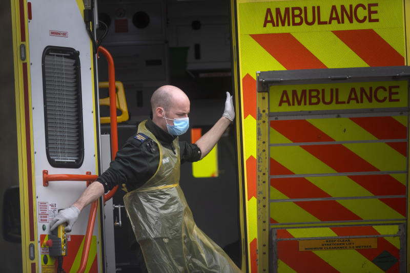 A London Ambulance worker wearing a protective face mask leaves an ambulance at St Thomas' Hospital in London as the UK continues in lockdown to help curb the spread of the coronavirus.