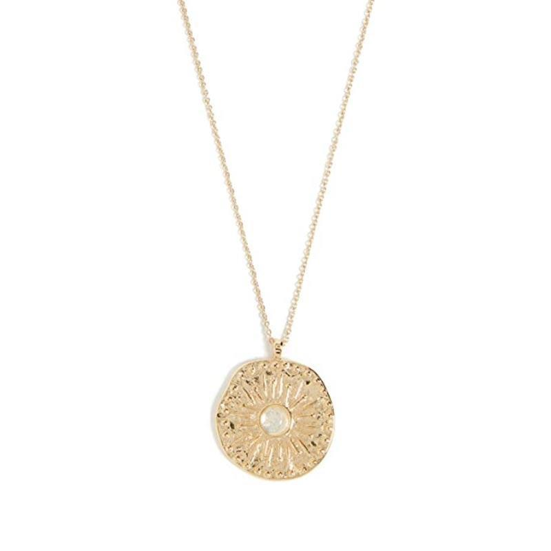 "Necklaces make some of the best gifts, and this one from Gorjana would look great with a cashmere crewneck or a <a href=""https://www.glamour.com/gallery/the-perfect-white-t-shirt-according-to-glamour-editors?mbid=synd_yahoo_rss"" rel=""nofollow noopener"" target=""_blank"" data-ylk=""slk:white T-shirt"" class=""link rapid-noclick-resp"">white T-shirt</a>. $65, Amazon. <a href=""https://www.amazon.com/gorjana-Womens-Maya-Necklace-Opalite/dp/B07V3958BZ?s=shopbop&ref_=sb_ts"" rel=""nofollow noopener"" target=""_blank"" data-ylk=""slk:Get it now!"" class=""link rapid-noclick-resp"">Get it now!</a>"