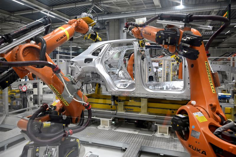 FILE PHOTO: Robotic arms are seen on an assembly line as the Volkswagen construction plant reopens after closing down last month due to the coronavirus disease (COVID-19) outbreak in Bratislava