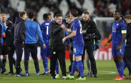 Britain Soccer Football - Leicester City v Sevilla - UEFA Champions League Round of 16 Second Leg - King Power Stadium, Leicester, England - 14/3/17 Leicester City manager Craig Shakespeare celebrates with Christian Fuchs after the game as Wes Morgan looks on Action Images via Reuters / Carl Recine Livepic