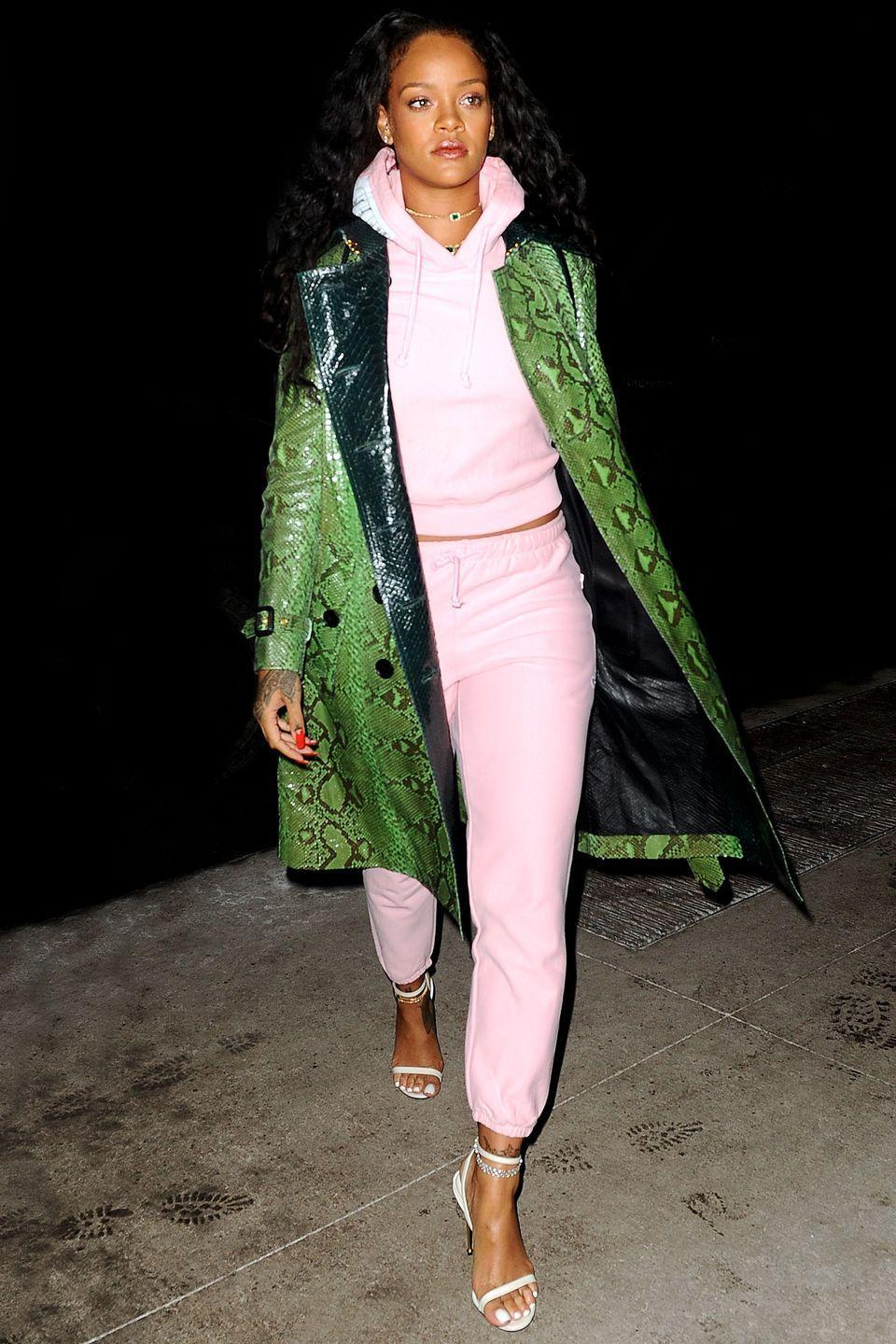<p>In a green python-print trench, baby pink sweats and white heeled sandals while out in New York City.</p>