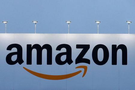 FILE PHOTO - The logo of Amazon is seen at the company logistics center in Lauwin-Planque, northern France on February 20, 2017.  REUTERS/Pascal Rossignol/File Photo