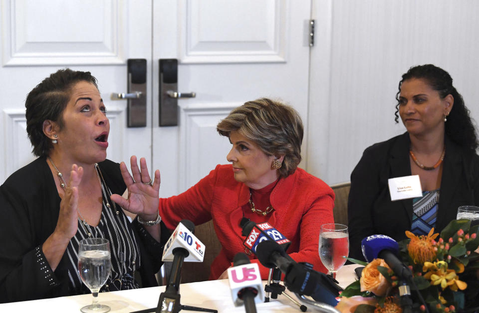 FILE - In this Sept. 23, 2018 file photo, attorney, Gloria Allred, center, along with her clients, Chelan Lasha, left, and Lise-Lotte Lublin, right, both of whom have accused Bill Cosby of sexual assault, talk to the media during a press conference at the Le Meridien Hotel in Philadelphia, Pa. Cosby has spent more than two years in prison since he was convicted of sexual assault in the first celebrity trial of the #MeToo era. Now the Pennsylvania Supreme Court is set to hear his appeal of the conviction on Tuesday, Dec. 1, 2020. The arguments will focus on the trial judge's decision to let five other accusers testify for the prosecution. (Jose F. Moreno/The Philadelphia Inquirer via AP, File)