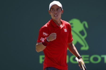 Mar 26, 2017; Miami, FL, USA; Kei Nishikori of Japan celebrates after winning match point against Fernando Verdasco of Spain (not pictured) on day six of the 2017 Miami Open at Crandon Park Tennis Center. Mandatory Credit: Geoff Burke-USA TODAY Sports