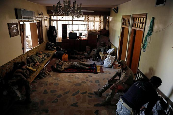<p>Iraqi soldiers from 9th Armoured Division rest inside a house that has become their temporary advance command post in the Shifa neighbourhood in western Mosul, Iraq, June 15, 2017. (Photo: Erik De Castro/Reuters) </p>