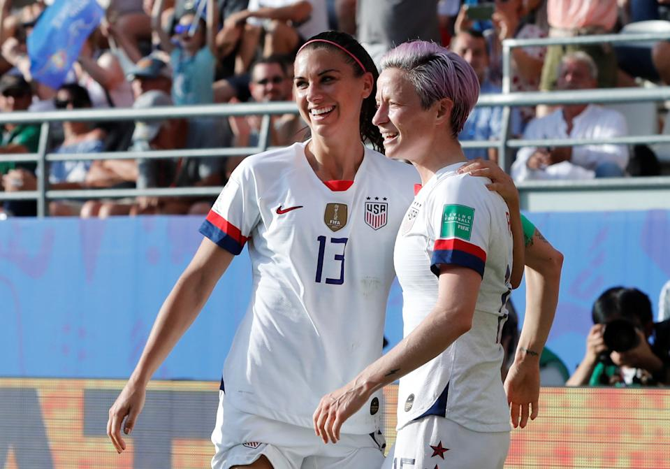 Soccer Football - Women's World Cup - Round of 16 - Spain v United States - Stade Auguste-Delaune, Reims, France - June 24, 2019 Megan Rapinoe of the U.S. celebrates scoring their second goal with Alex Morgan of the U.S.   REUTERS/Bernadett Szabo