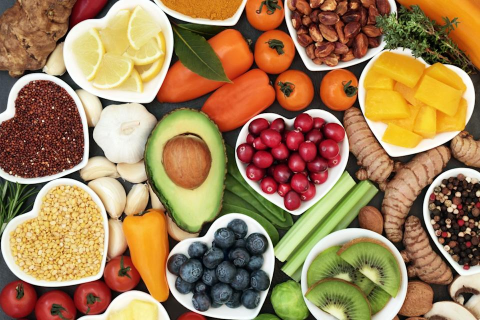 Health food for fitness concept with fruit, vegetables, pulses, herbs, spices, nuts, grains and pulses. High in anthocyanins, antioxidants, smart carbohydrates, omega 3, minerals and vitamins