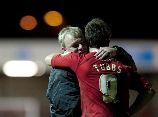 "Crawley Town's Manager Steve Evans (L) hugs his striker Matt Tubbs (R) after the game against Bristol City during the FA Cup third round football match at Broadfield Stadium in Crawley on January 7, 2012. Tubbs scored the only goal in the match and Crawley Town won the game 1-0 and advance to the fourth round of the FA cup. AFP PHOTO / ADRIAN DENNIS RESTRICTED TO EDITORIAL USE. No use with unauthorized audio, video, data, fixture lists, club/league logos or ""live"" services. Online in-match use limited to 45 images, no video emulation. No use in betting, games or single club/league/player publications"