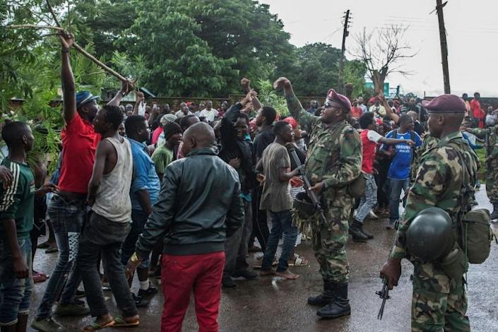 Protests have broken out in the Malawian capital Lilongwe following accusations that bribes were offered to the five judges on the case (AFP Photo/Amos GUMULIRA)