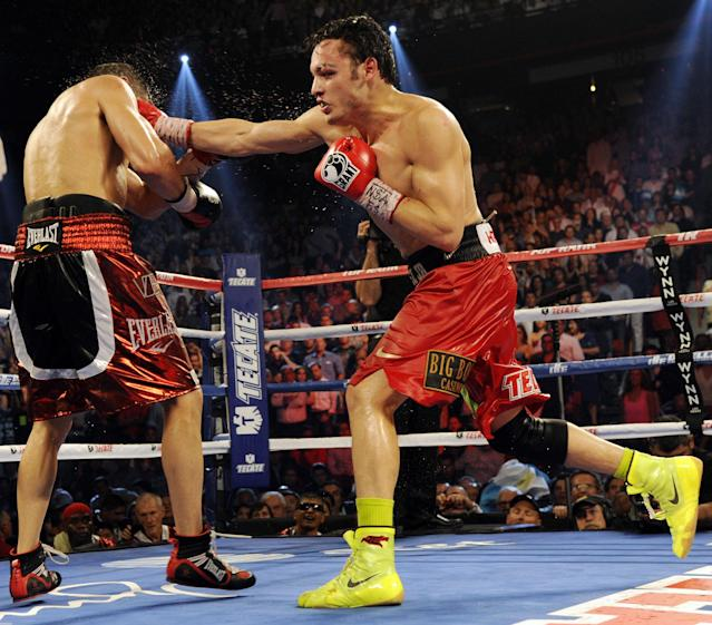 LAS VEGAS, NV - SEPTEMBER 15: Julio Cesar Chavez Jr. (L) lands a right to the head of Sergio Martinez in the second round during their WBC middleweight title fight at the Thomas & Mack Center on September 15, 2012 in Las Vegas, Nevada. (Photo by Jeff Bottari/Getty Images)