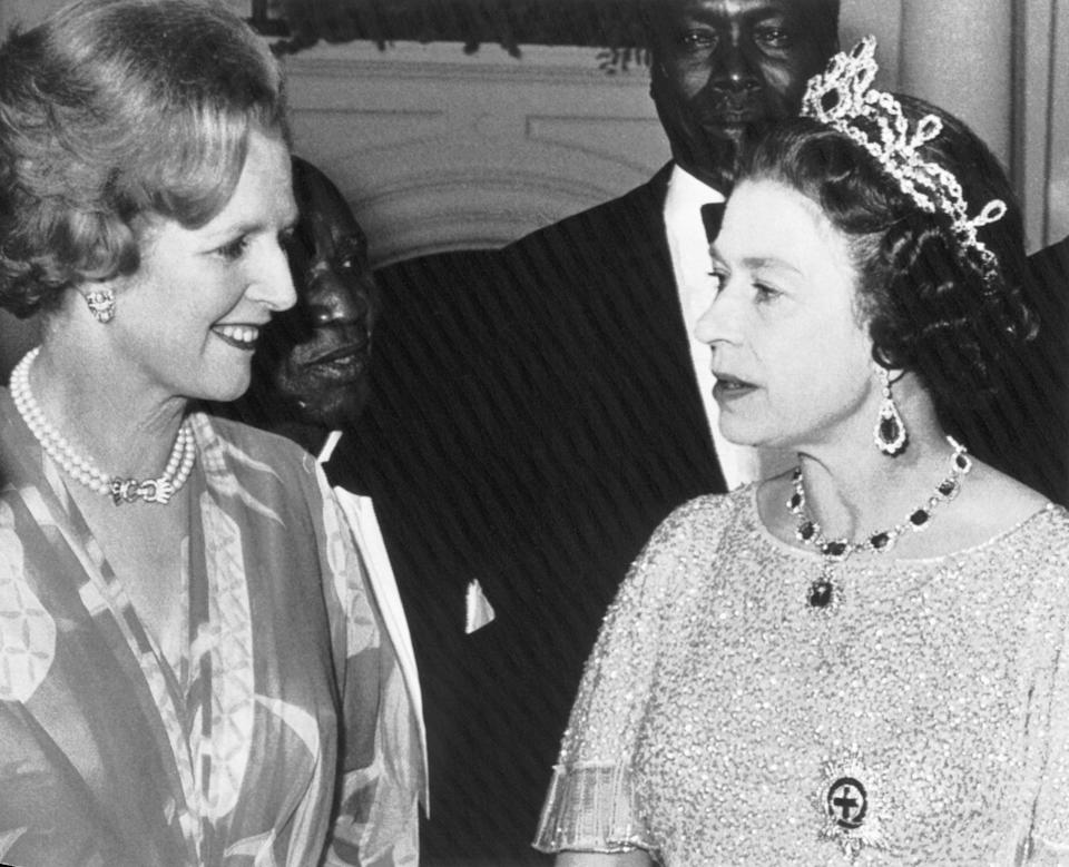(Original Caption) 8/1/1979-Lusaka, Zambia- British Prime Minister, Margaret Thatcher(left), and Queen Elizabeth, chat at a party for the Heads of State gathered here for the Commonwealth Conference. Looking on in the rear are; Dr. Hasting Banda(left) of Malawi and Arap Moi of Kenya.