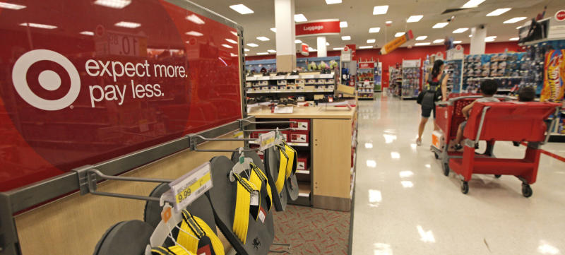 A customer pulls her cart down an aisle at a Target store on Thursday, July 5, 2012, in Chicago. The discount retailer said Thursday that a key revenue measure rose 2.1 percent in June as shoppers spent more on food and health and beauty items. But the growth in revenue at stores open at least one year was slightly lower than the 2.4 percent rise that analysts surveyed by Thomson Reuters expected. (AP Photo/M. Spencer Green)
