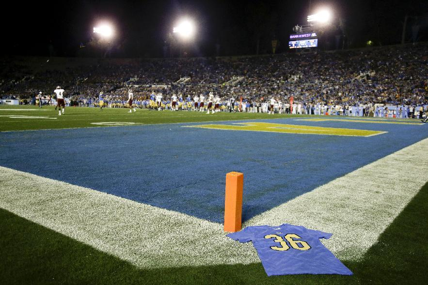 A t-shirt sits on the field honoring UCLA wide receiver Nick Pasquale before an NCAA college football game against New Mexico State Saturday, Sept. 21, 2013, in Pasadena, Calif. Pasquale was struck and killed by a car Sunday, Sept. 8, in San Clemente, Calif. (AP Photo/Chris Carlson)