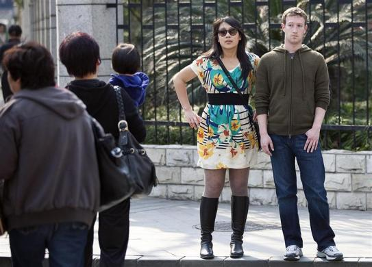 Facebook CEO Mark Zuckerberg and his girlfriend Priscilla Chan walk near Fuxing Road in Shanghai, March 27, 2012.