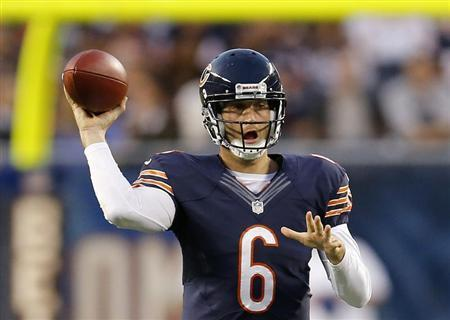 Chicago Bears' Jay Cutler makes a pass against the San Diego Chargers during the first half of a pre-season NFL football game in Chicago, Illinois, August 15, 2013. REUTERS/Jim Young