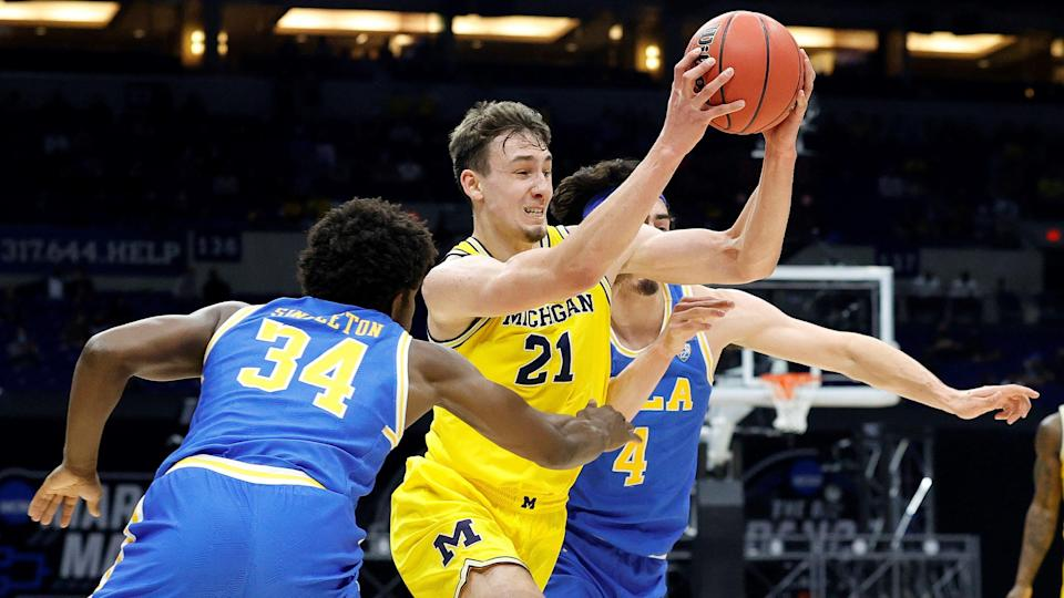 INDIANAPOLIS, INDIANA - MARCH 30: Franz Wagner #21 of the Michigan Wolverines dribbles against David Singleton #34 of the UCLA Bruins during the first half in the Elite Eight round game of the 2021 NCAA Men's Basketball Tournament at Lucas Oil Stadium on March 30, 2021 in Indianapolis, Indiana. (Photo by Tim Nwachukwu/Getty Images) ORG XMIT: 775630332 ORIG FILE ID: 1310022272