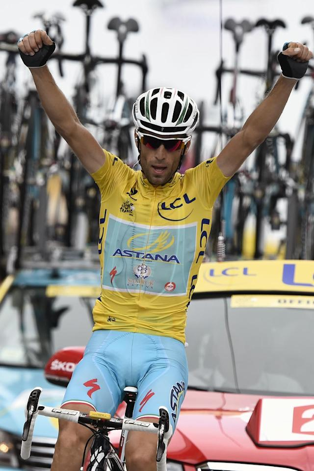 Italy's Vincenzo Nibali celebrates as he crosses the finish line at the end of the 18th stage of the 101st edition of the Tour de France between Pau and Hautacam, on July 24, 2014 (AFP Photo/Eric Feferberg)