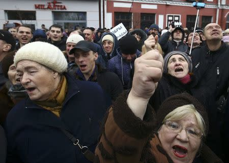 People shout slogans during protest against increased tariffs for communal services and new taxes, including tax for those who are not in full-time employment, in Bobruisk
