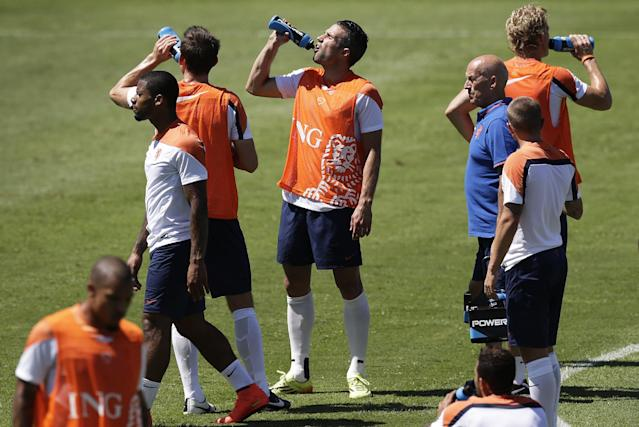 Soccer players from the Netherlands national team rehydrate during their official training session in Fortaleza, Brazil, Saturday, June 28, 2014. Netherlands will play Group A runner-up Mexico in the second round on Sunday in Fortaleza.(AP Photo/Wong Maye-E)