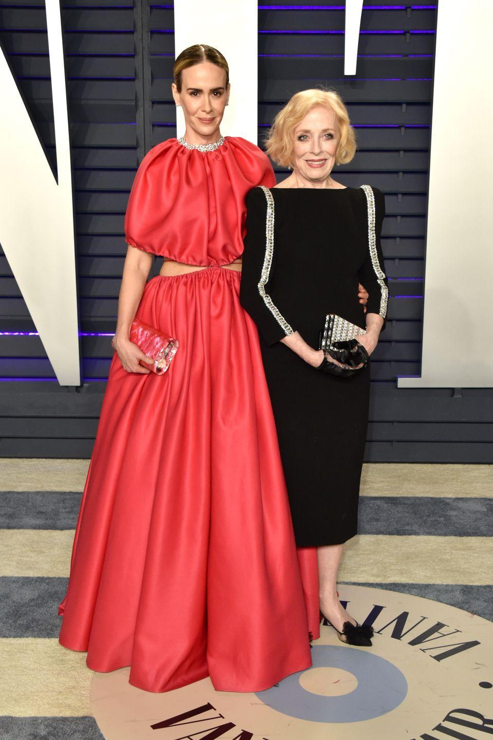 "<p>Rumors <a href=""http://www.etonline.com/news/177170_holland_taylor_is_dating_sarah_paulson"" rel=""nofollow noopener"" target=""_blank"" data-ylk=""slk:started swirling"" class=""link rapid-noclick-resp"">started swirling</a> in 2015 that <em>American Horror Story</em> star Sarah Paulson, then 41, was dating 72-year-old Holland Taylor. Paulson later confirmed their relationship in <a href=""https://www.nytimes.com/2016/03/03/fashion/sarah-paulson-opens-up-about-dating-older-women-holland-taylor.html"" rel=""nofollow noopener"" target=""_blank"" data-ylk=""slk:an interview"" class=""link rapid-noclick-resp"">an interview</a> with the <em>New York Times</em> in 2016, stating: ""What I can say absolutely is that I am in love, and that person happens to be Holland Taylor.""</p>"