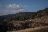 The Wider Image: Oregon inmates find redemption in fighting wildfires