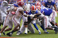 Florida quarterback Emory Jones (5) pushes his way past the Alabama defense including defensive back DeMarcco Hellams (2) for a 5-yard touchdown run during the second half of an NCAA college football game, Saturday, Sept. 18, 2021, in Gainesville, Fla. (AP Photo/John Raoux)