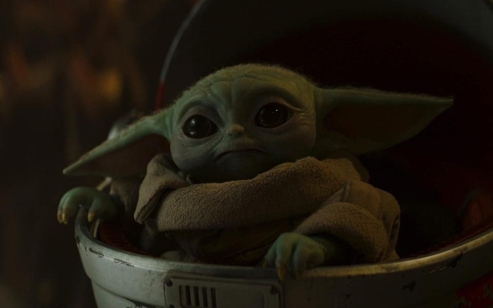 """The Child, aka """"Baby Yoda"""", has been a hit with fans and Disney marketeers alike - Disney"""