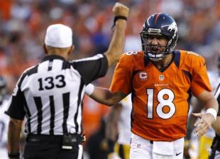Peyton Manning shows a bit of emotion in his debut with the Broncos. (AP)