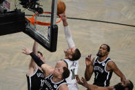 Milwaukee Bucks' Brook Lopez (11) shoots over Brooklyn Nets' Blake Griffin, front left, Kevin Durant (7) and James Harden, right, during the second half of Game 7 of a second-round NBA basketball playoff series Saturday, June 19, 2021, in New York. (AP Photo/Frank Franklin II)
