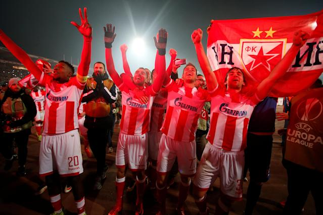 Soccer Football - Europa League - Red Star Belgrade vs FC Cologne - Rajko Mitic Stadium, Belgrade, Serbia - December 7, 2017 Red Star Belgrade's Mitchell Donald, Nenad Krsticic, Marko Gobeljic and Filip Stojkovic celebrate at the end of the match REUTERS/Novak Djurovic