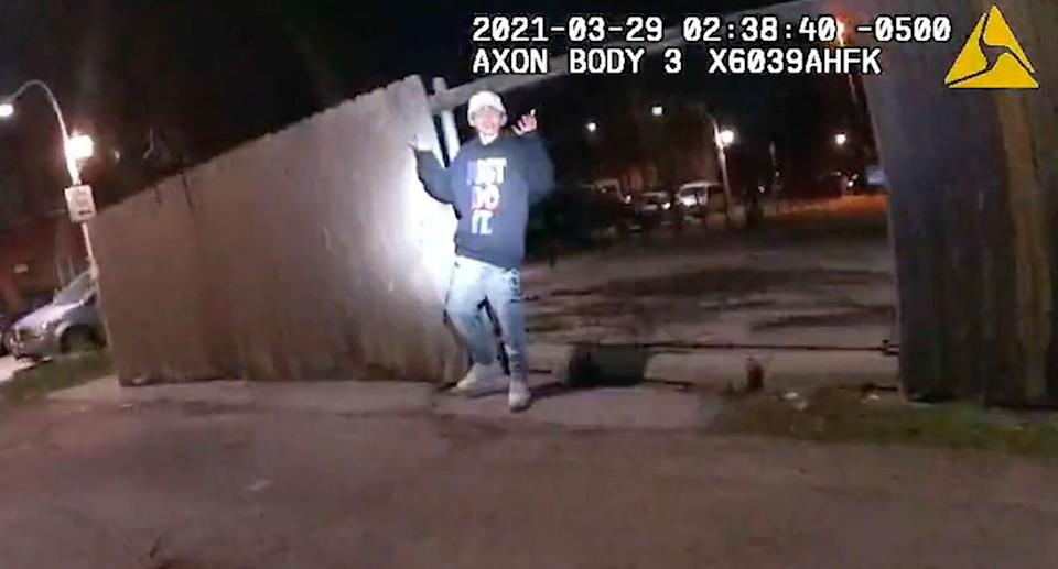 A still from bodycam footage shows Adam Toledo with his hands raised without a weapon in his hand.