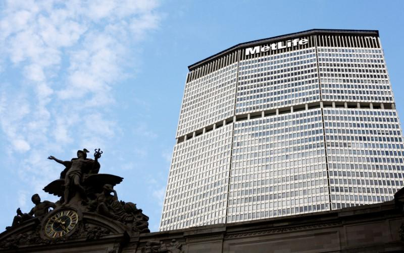 FILE PHOTO - Statue stands atop Grand Central Station in front of the MetLife building in New York