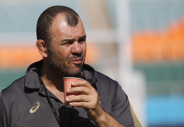 Australia rugby coach Michael Cheika drinks during a training session at Shizuoka Stadium Ecopa, Japan, Thursday, Oct. 10, 2019. Australia will play tomorrow against Georgia during their Rugby World Cup Pool D game. (AP Photo/Christophe Ena)
