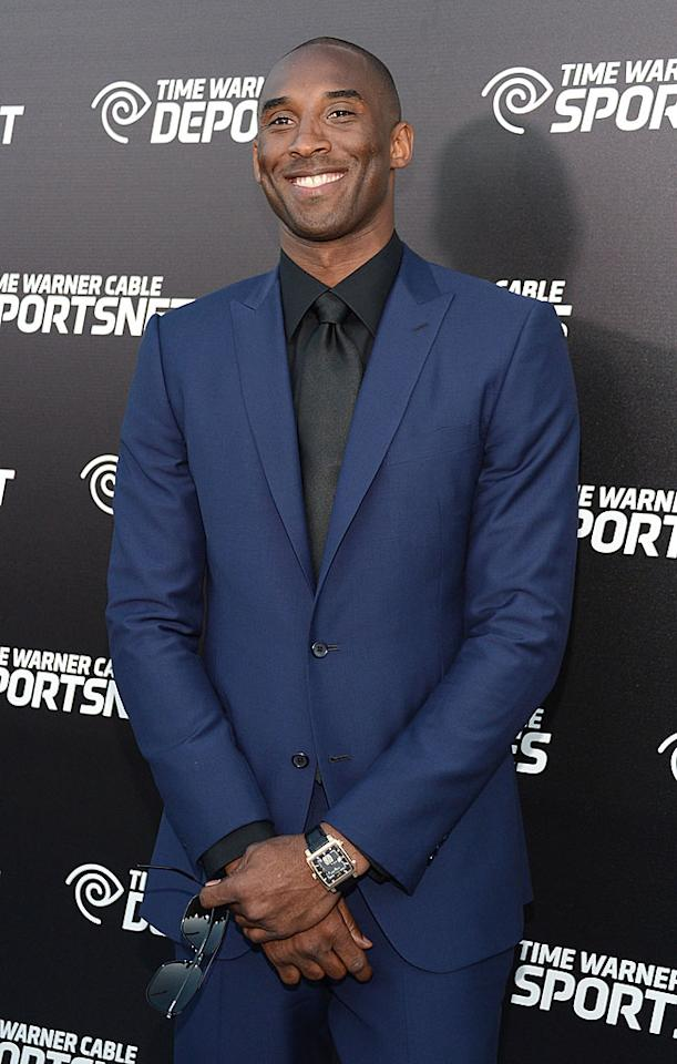 """Lakers team captain Kobe Bryan looked dapper in a midnight blue suit with a black shirt and tie. But he still had basketball on the brain. He told reporters he was """"looking forward to the challenge"""" of the upcoming season after being defeated early in the playoffs the past two years. (10/1/2012)"""