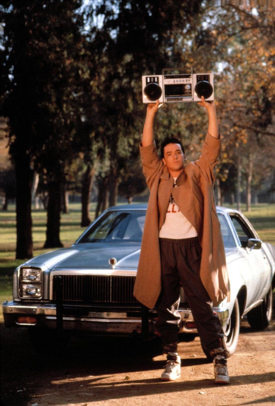 <ul> <li><strong>What to wear:</strong> A trench coat, sneakers, baggy pants, and a boom box (or a makeshift boom box).</li> </ul>
