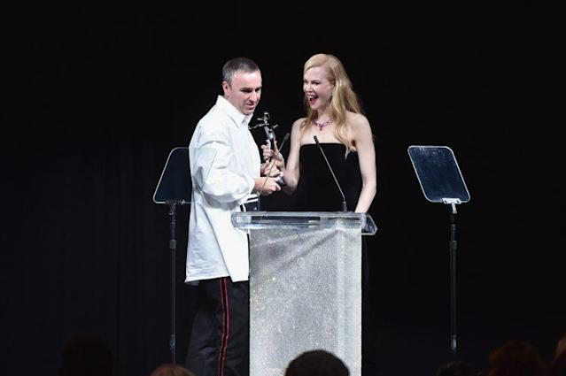 Raf Simons, the creative director of Calvin Klein, accepts his Womenswear Designer of the Year award, presented by Nicole Kidman. (Photo: Getty Images)