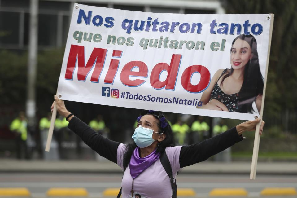 "A woman holds a banner that reads in Spanish ""They took so much that they even took away our fear,"" during an International Women's Day protest in Bogota, Colombia, Monday, March 8, 2021. (AP Photo/Fernando Vergara)"