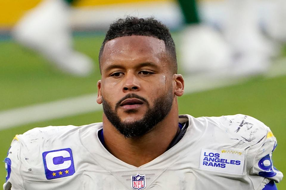 Los Angeles Rams defensive tackle Aaron Donald (99) walks off the field after a loss to the New York Jets in an NFL football game in Inglewood, Calif., in this Sunday, Dec. 20, 2020, file photo. A lawyer and his 26-year-old client told Pittsburgh police Wednesday, April 14, 2021, that Los Angeles Rams defensive lineman Aaron Donald and others assaulted the man at a nightclub last weekend, causing multiple injuries.