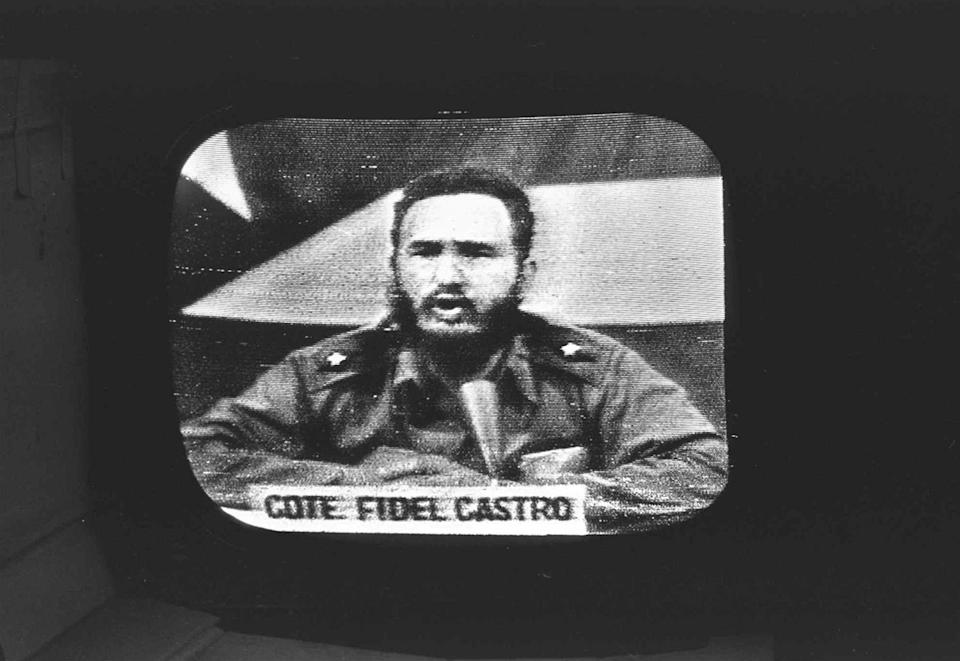 """<p>Cuban President Fidel Castro replies to President Kennedy's naval blockade via Cuban radio and television on October 23, 1962. To defuse the Cuban missile crisis, President Kennedy promised not to invade the island nation, but newly declassified documents show he later retreated from the pledge, fearing Cuba could become an """"""""invulnerable base."""" The change of heart meant that the U.S.-Soviet understandings that resolved the 1962 crisis were never made permanent. (AP Photo/file) </p>"""