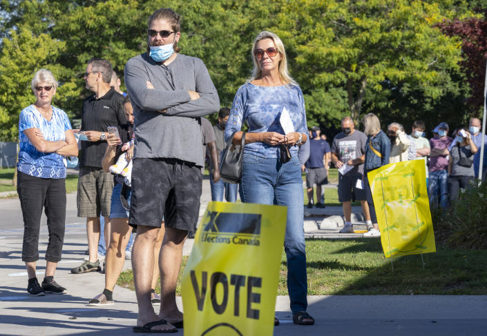 <p>Voters line up at a polling station to vote in the Canadian federal election in Bowmanville, Ont., on Monday, Sept. 20, 2021.THE CANADIAN PRESS/Frank Gunn</p>