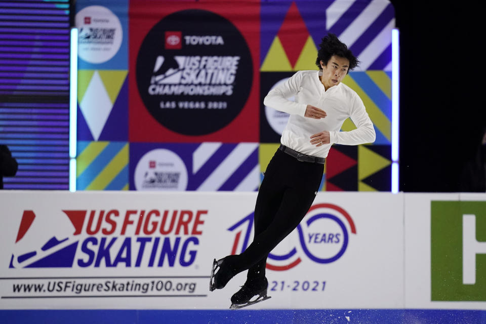 "FILE - In this Saturday, Jan. 16, 2021, file photo, Nathan Chen competes during the men's short program at the U.S. Figure Skating Championships in Las Vegas. As Nathan Chen seeks a third straight World Figure Skating Championships title, something no American has achieved since Scott Hamilton got his fourth in a row in 1984, he has two major challenges in front of him. One is two-time Olympic gold medalist Yuzuru Hanyu of Japan, who Chen calls ""the benchmark."" The other is idleness in major competitions forced by the coronavirus pandemic. (AP Photo/John Locher, File)"