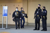 Police and FBI agents investigate a shooting at the Mayfair Mall, Friday, Nov. 20, 2020, in Wauwatosa, Wis. Multiple people were shot Friday afternoon at the mall, and police are still searching for the shooter. (AP Photo/Nam Y. Huh)