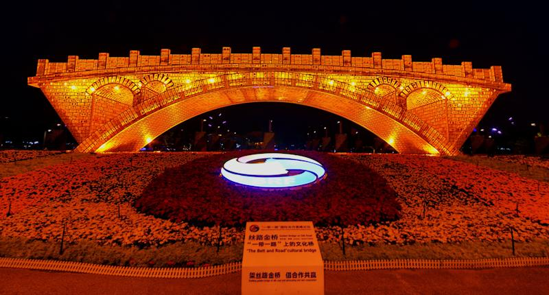 BEIJING, CHINA - APRIL 26: The Golden Bridge on Silk Road is illuminated during a light show to welcome the Second Belt and Road Forum for International Cooperation at Olympic Green on April 26, 2019 in Beijing, China. The 2nd Belt and Road Forum for International Cooperation is held in Beijing on April 25-27. (Photo by Lin Hui/Qianlong.com/VCG via Getty Images)