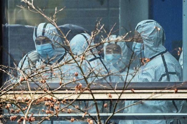 PHOTO: Members of the World Health Organization team investigating the origins of the COVID-19 coronavirus are seen during their visit to the Hubei Center for animal disease control and prevention in Wuhan, China's central Hubei province on Feb. 2, 2021. (Hector Retamal/AFP via Getty Images, FILE)