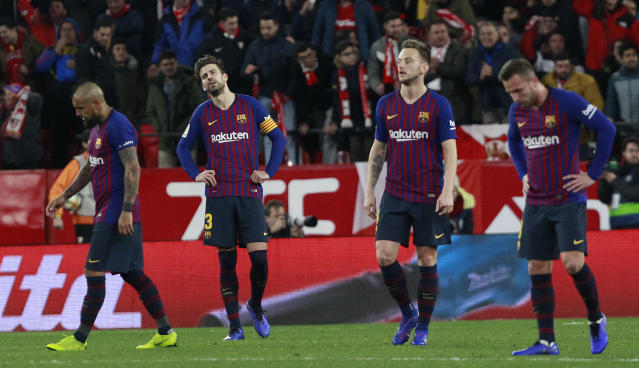 FC Barcelona's Gerard Pique, second left, reacts after Sevilla's Pablo Sarabia scored during a Spanish Copa del Rey soccer match between Sevilla and FC Barcelona in Seville, Spain, Wednesday Jan. 23, 2019. (AP Photo/Miguel Morenatti)
