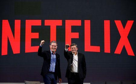 Reed Hastings, co-founder and CEO of Netflix, and Ted Sarandos, Netflix chief content officer, pose for photographs during a news conference in Seoul