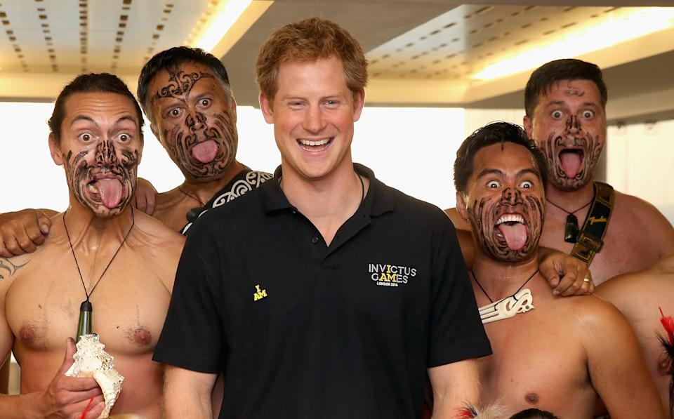 LONDON, ENGLAND - SEPTEMBER 08:  Prince Harry poses with Ngati Ranana Maori Dancers as he meets the New Zealand Invictus Team at New Zealand House on September 8, 2014 in London, England. The International sports event for 'wounded warriors', presented by Jaguar Land Rover, is just days away with limited last-minute tickets available at www.invictusgames.org  (Photo by Chris Jackson/Getty Images)